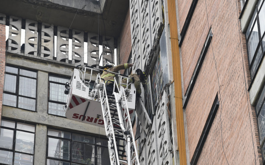 A group of firefighters work on a building, damaged during the 8.2 earthquake that hit early today, in Mexico City on September 8, 2017.  Mexico's most powerful earthquake in a century killed at least 35 people, officials said, after it struck the Pacific coast, wrecking homes and sending families fleeing into the streets. / AFP PHOTO / ALFREDO ESTRELLA        (Photo credit should read ALFREDO ESTRELLA/AFP/Getty Images)